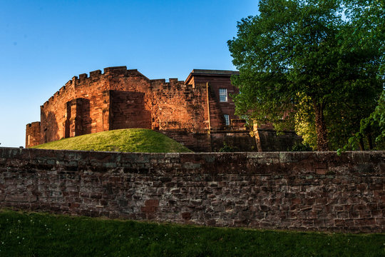 Chester medieval Castle at sunset, beyond the city wall. The castle and the walls are one of the major tourist attraction of the City of Chester.
