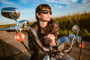 Leinwandbilder - Biker girl sitting on motorcycle