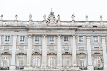 Royal Palace in Madrid with sculptures on roof