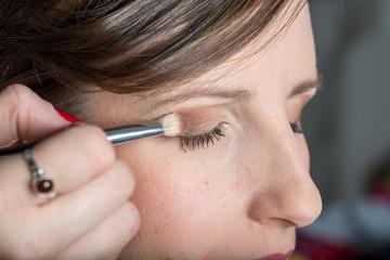 Professional make-up artist applying discrete makeup