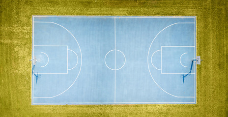 aerial view on outdoor blue basketball court.