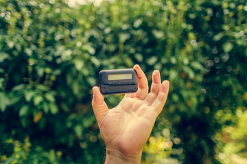 pagers. old vintage beeper. pager in hand