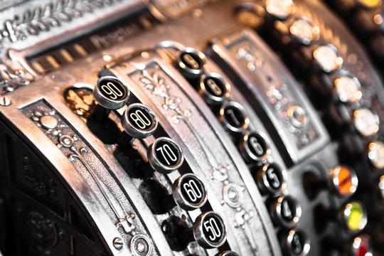 Antique metal cash register with diferent numbers