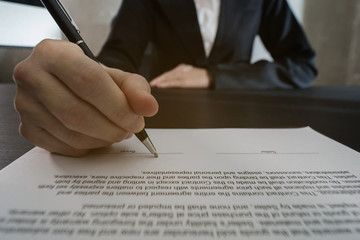 Female signing contract, business successful