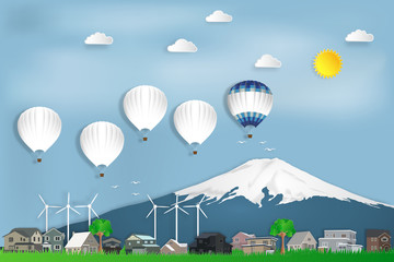 The hot air balloons travel over Fuji mountain in Japan and countryside on blue sky as trip in the holiday , paper art and craft style concept. vector illustration.