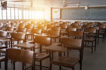 Empty classroom with vintage tone wooden chairs. Back to school concept. Wall mural