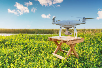 drone quad copter on green corn field