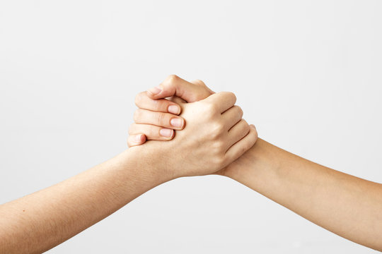Two hands holding each other strongly
