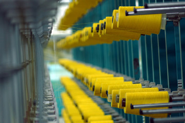 Industrial textile factory. Coils with threads in production.Fabric production .