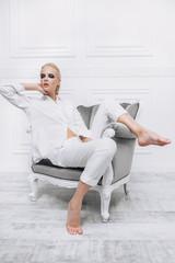 lying on an armchair