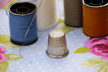 Sewing cotton and thimble