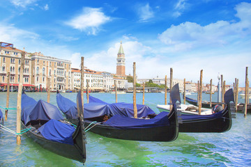 Beautiful view of the gondola and bell tower of Campanella in the Venetian lagoon, Venice, Italy