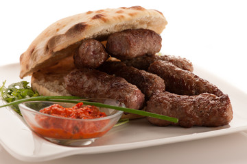 photo of Cevapi, cevapcici, traditional Balkan food - delicious minced meat.