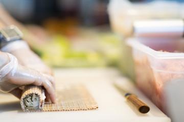 Sushi preparation in japanese restaurant