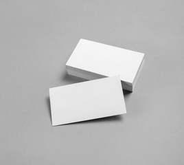 Blank business cards on gray paper background. Template for placing your design.
