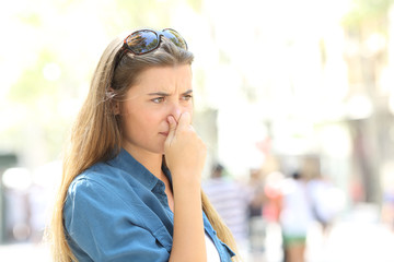 Girl covering her nose due to bad odour