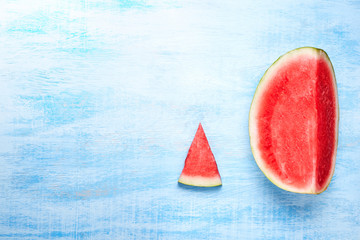 Watermelon slices on the on blue background. Top view, flat lay.