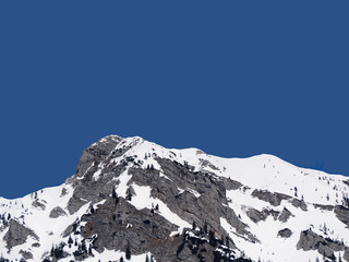 Wall Mural - Snowy mountain peak with blue sky