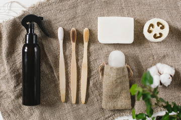 sustainable lifestyle concept. eco natural bamboo toothbrush, crystal deodorant,luffa, coconut soap,cotton. zero waste flat lay. bathroom essentials, plastic free items