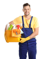 Male janitor with cleaning supplies on white background