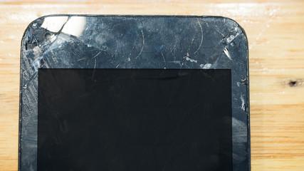 Wall Mural - Broken screen phone on wood table