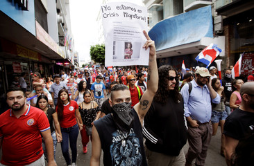 Demonstrators march against Nicaraguan refugees who fled their country due to unrest, in San Jose