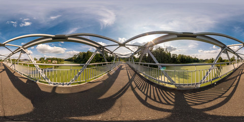 full seamless spherical panorama 360 by 180 angle view neariron steel frame construction of pedestrian bridge across the river in equirectangular projection, skybox VR virtual reality content