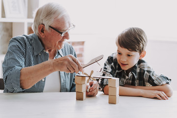 Grandpa and Grandson Playing with Toys at Home