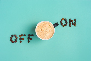 """Coffee lay flat on turquoise background with words """"on off """"concept image."""