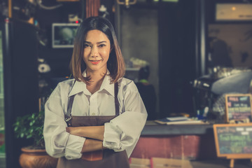 Asian woman barista successful small business owner standing in cafe. vintage color