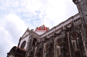 low view angle of stained glass and dome of Parroquia de San Francisco de Asís