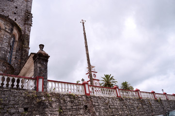 wooden pole for dance of the flyers and clock tower Cuetzalan Puebla
