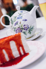 Strawberry crepe cake with tea pot background..strawberry crepes cake with strawberry sauce, dessert at bakery
