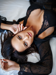 Seductive girl in a black sexy lingerie