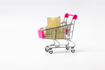 Shopping cart with paper cartons on white background.