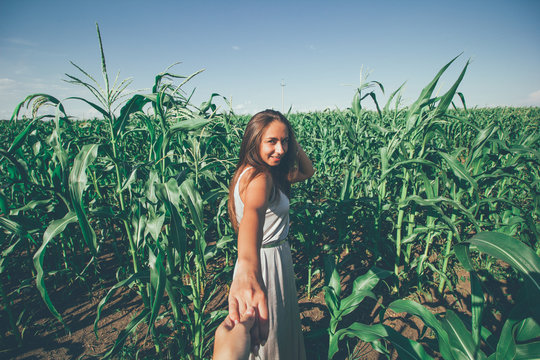 beautiful young woman tanned skin silver dress in the corn field portrait of follow me