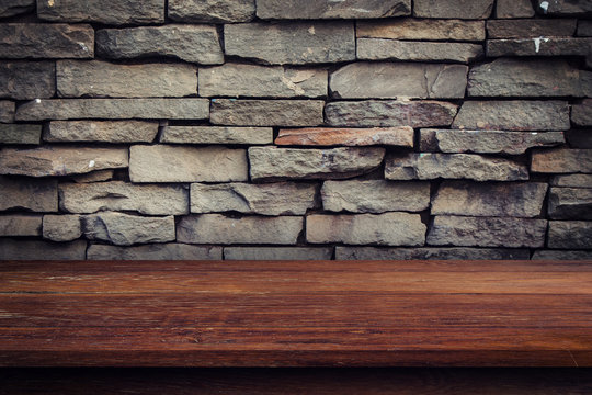 Empty wood table and grunge brick wall and display montage for product.