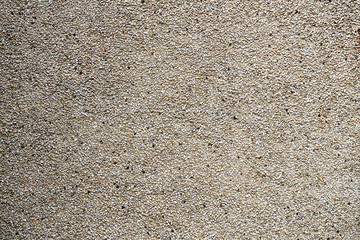 Outdoor stone wall textured bacground grey and weathered