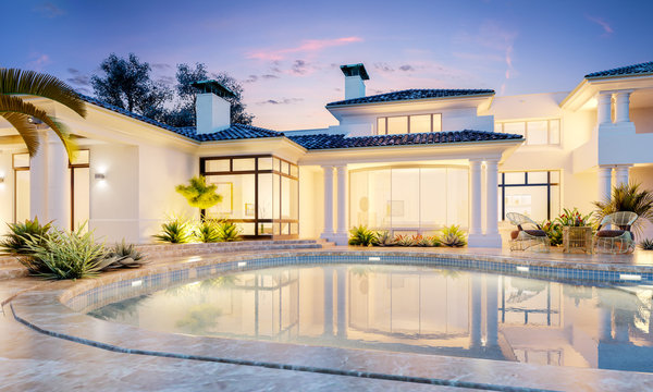 Backyard with a pool in an expensive mansion. Very beautiful sunset in private house.