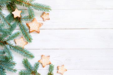 Natural white wooden background with spruce brunches and cookies