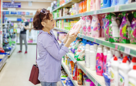 European woman customer buying detergents home appliances cosmetics for laundry in shopping mall