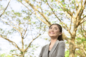 Smiling asian business woman with happy expression