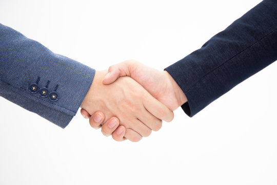 Successful business men shake hands isolated on white background