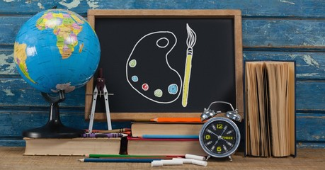 Art palette and brush Education drawing on blackboard for school