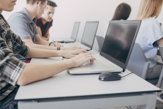 Group of High School Students Using Laptops