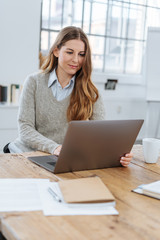 Young businesswoman or student working at her desk