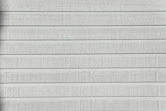 White shiplap rough texture in bright sunlight.