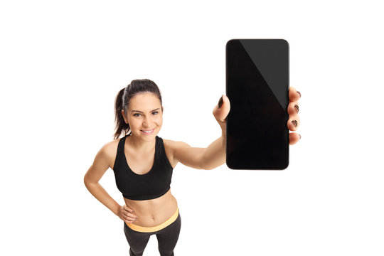 Young woman in sportswear holding a cell phone