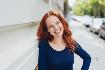 Relaxed confident young redhead woman