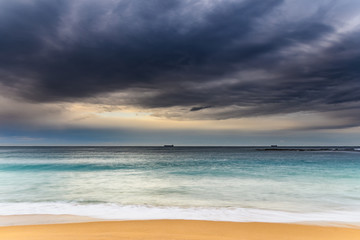 Early morning seascape with heavy clouds
